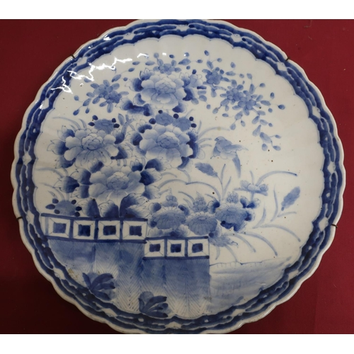 7 - Japanese waved edge circular blue and white charger, all over decorated with chrysanthemums on a ter...
