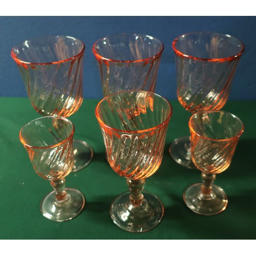 56 - Suite of rose tinted glassware including stemmed wine glasses, sherry, liquors etc