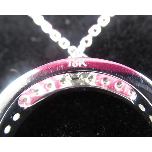 88 - 18ct white gold diamond halo style pendant...