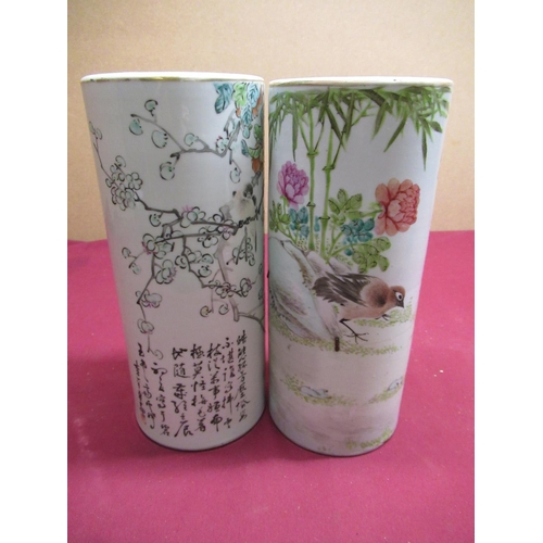 187 - Pair of Chinese Republic style cylindrical vases decorated with bird and foliage and script, red sea...