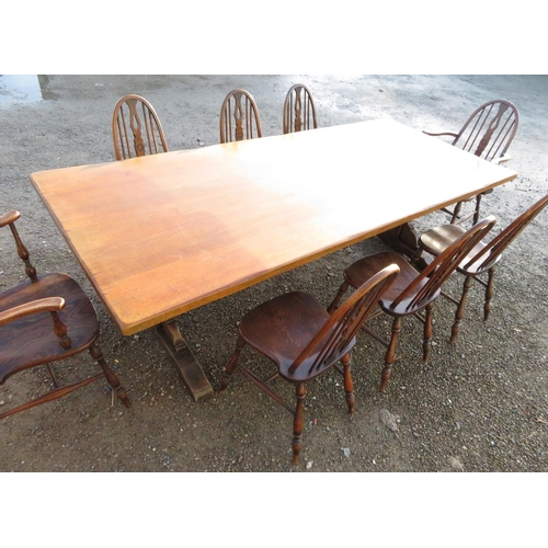 1329 - Large oak refectory style dining table, solid top on trestle end support joined by a cross stretcher...