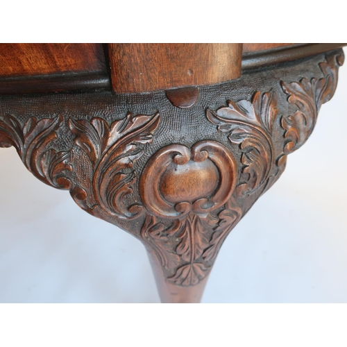 1318 - Geo.III style mahogany extending dining table, with gadroon carved oval top on C scroll carved legs ...