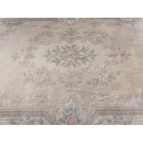 1326 - Chinese woollen cream ground rug, central floral medallion within a triple stripe, floral and scroll...