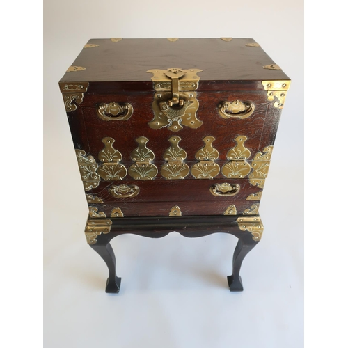 1314 - 20th C Japanese brass bound elm cabinet on stand, fall front above a drawer on angular cabriole legs...