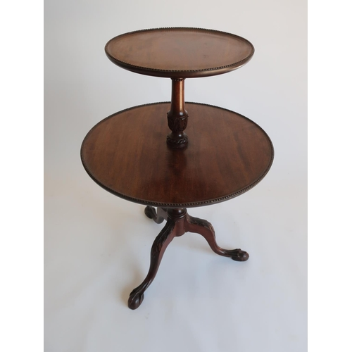 1317 - Geo.III style mahogany dumb waiter, two graduated circular tiers with beaded edge on leaf carved col...