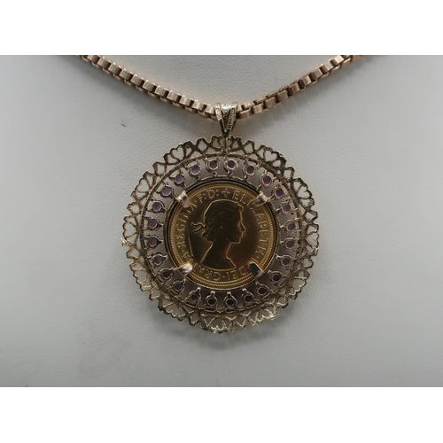 1142 - ER.ll Sovereign 1967, in 9ct hallmarked gold pierced and amethyst set loose mount, on 9ct box chain,...