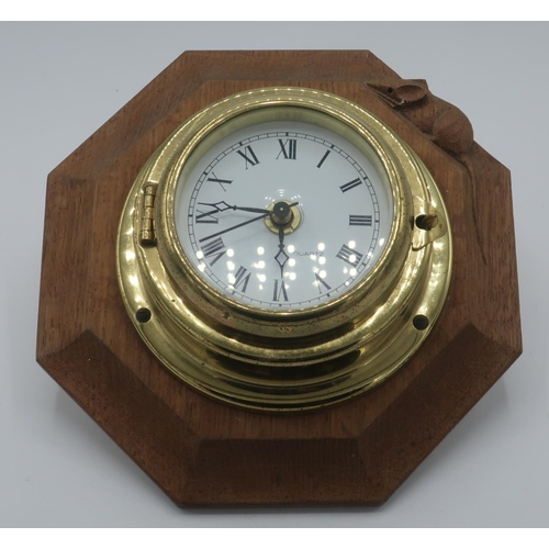 1010 - Robert Mouseman Thompson - a bulkhead type brass wall clock on octagonal backplate, carved with sign...