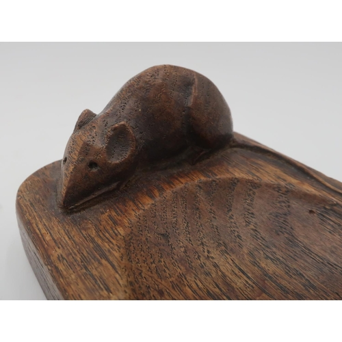 1011 - Robert Mouseman Thompson - a pair of adzed oak ashtrays, carved left and right facing, carved with s...