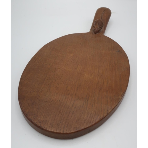 1019 - Robert Mouseman Thompson - an adzed oak oval cheeseboard, handle carved with signature mouse L37cm