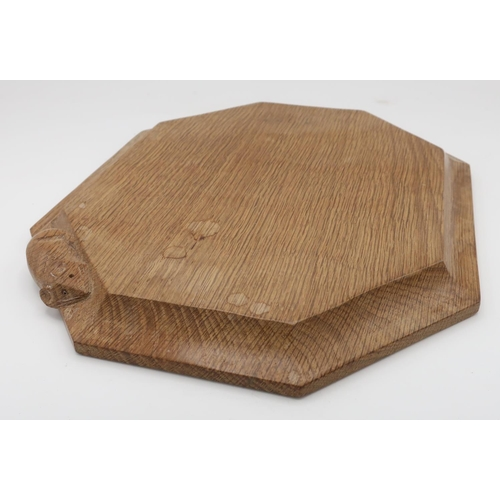 1020 - Robert Mouseman Thompson - an adzed oak bread board, carved with signature mouse, W30.5cm D25cm