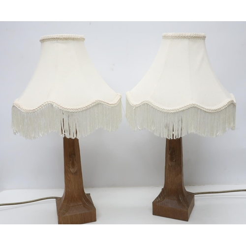 1031 - Robert Mouseman Thompson - a pair of adzed oak octagonal table lamps, on leaf carved square bases ca...
