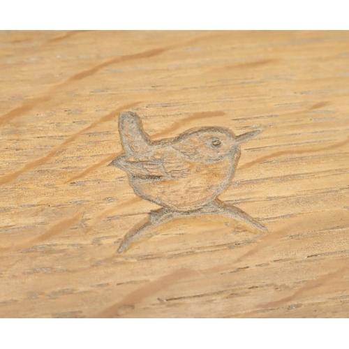 1041 - Bob Wren Man Hunter - a small oak book trough of angular form, incised with signature wren W30cm D17...