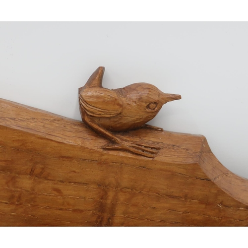 1042 - Bob Wren Man Hunter - an oak spoon rack, with arched top and single shelf, carved with signature wre...