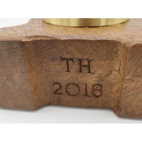 1043 - Trevor Squirrelman Hutchinson - an adzed oak mantel clock, with quartz movement in arched case, with...