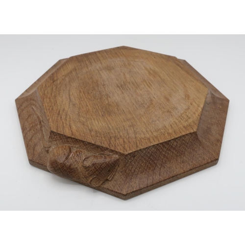 1009 - Robert Mouseman Thompson - an adzed oak octagonal teapot stand, carved with signature mouse, D19cm