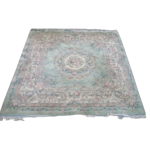 1328 - Chinese embossed woollen washed rug, green ground  floral central patterned medallion, rose floral b...