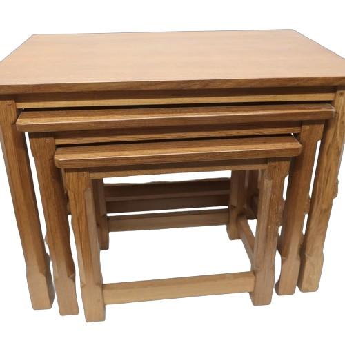 1004 - Robert Mouseman Thompson - a nest of three occasional tables, rectangular adzed tops on octagonal su...