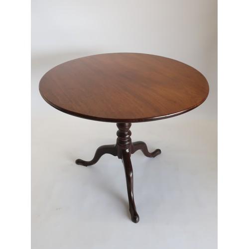 1338 - Geo.III mahogany tea table, one piece tilt top on birdcage movement, baluster stem on three outsplay...