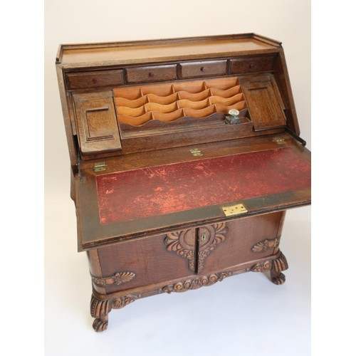 1345 - 1940's oak bureau, galleried top above a fall front with slide out stationary compartments and ink w...