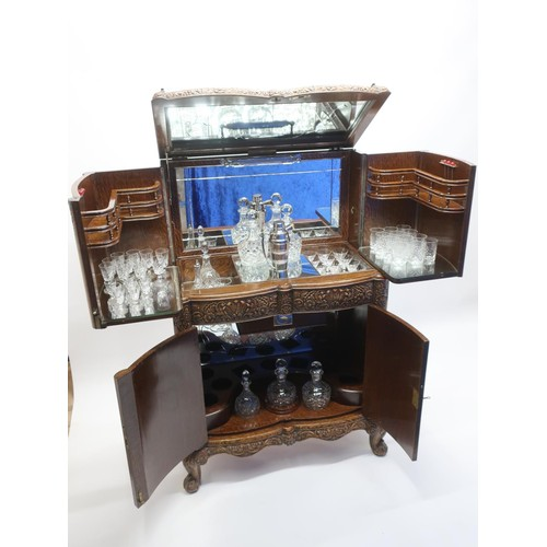 1344 - Good 1940's oak cocktail cabinet with four burr doors, galleried lifting top with decorated mirror, ...