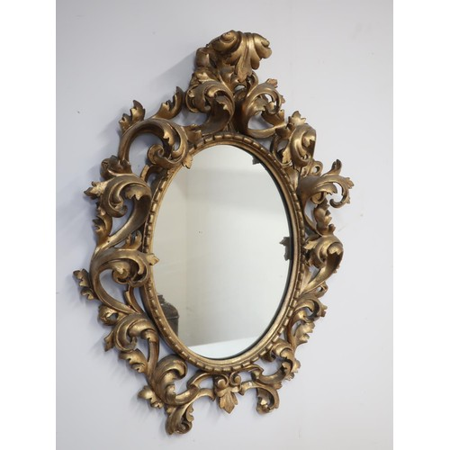 1341 - 18th century Florentine style giltwood wall mirror, with oval plate in C scroll and acanthus openwor...