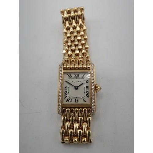 1115 - Ladies Cartier 18k gold Tank quartz wrist watch, textured Roman dial with diamond sides, case stampe...