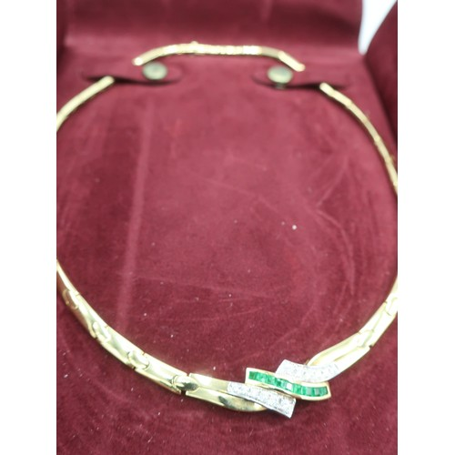 1138 - 18K gold Art Deco style articulated collar necklace, angular crossover set with emerald and diamond ...