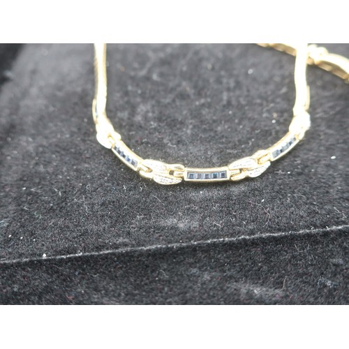 1137 - 18K gold collar necklace, set with alternate sapphire and diamond links, L41cm and a matching bracel...