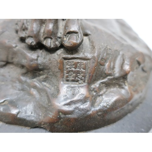 1350 - Pair of brown patinated bronze models of musician Pixies, one playing a flute, the other a shell, on...