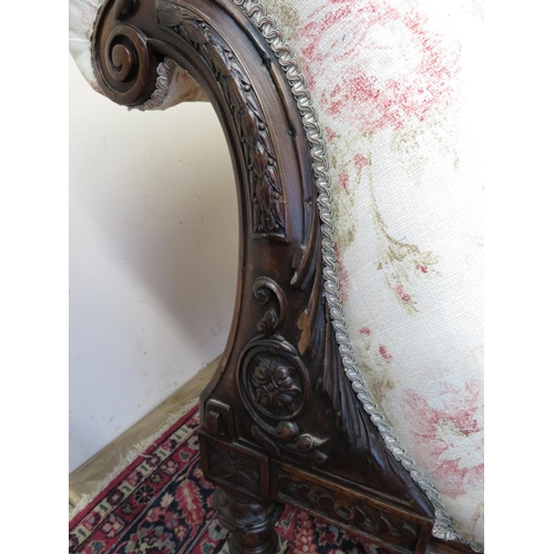 1348 - Victorian mahogany chaise longue, frame carved with flowers and scrolls, on turned tapering supports...