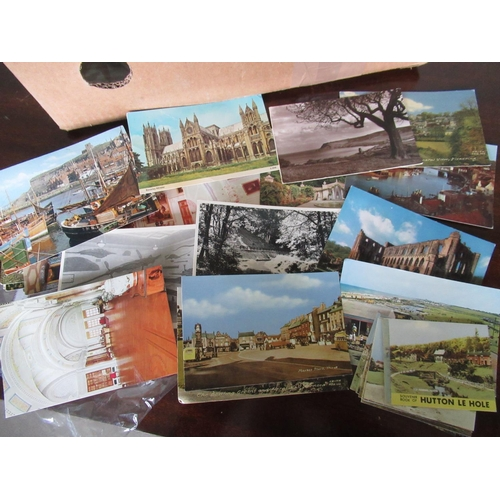 104 - Topographical printed colour and real photographic British postcards, loose cigarette cards, mostly ...