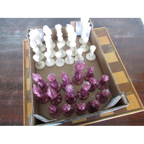 121 - Glazed earthenware chess set complete with board