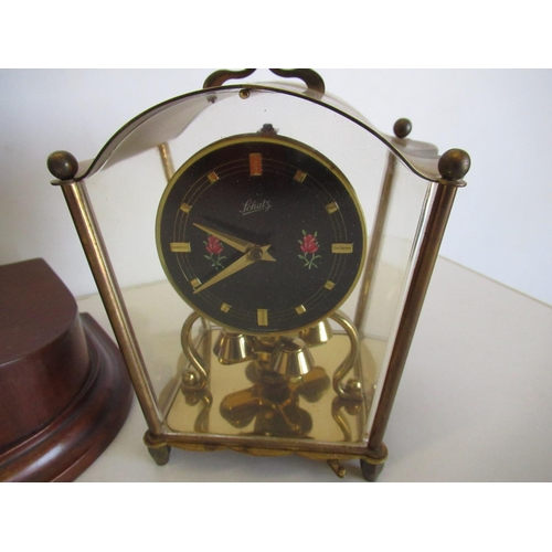 409 - 1930s mahogany cased mantle clock with two-train striking movement on a gong and a Schatz 400 day su...