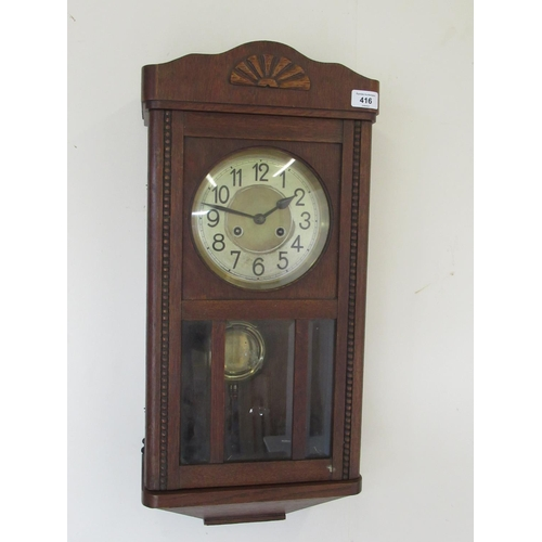 416 - 1930's H & B oak cased wall clock, glazed panelled door enclosing two train movement striking on a g...