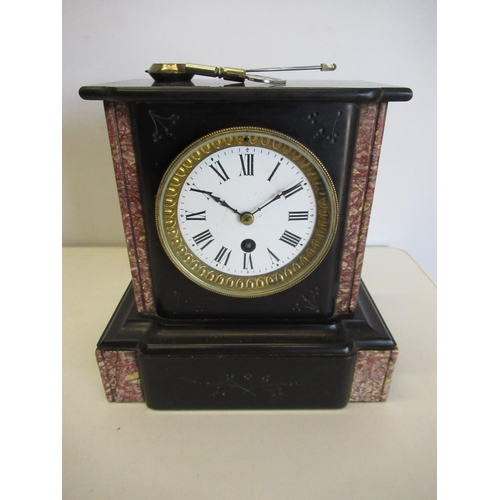 423 - 19th C mantel time piece, slate and pink variegated marble stepped and moulded case. 8 day French mo...