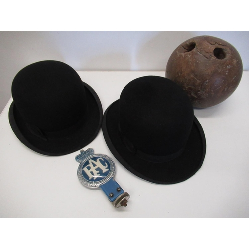 433 - Early bowling ball, Christies bowler hat, another bowler, an RAC badge