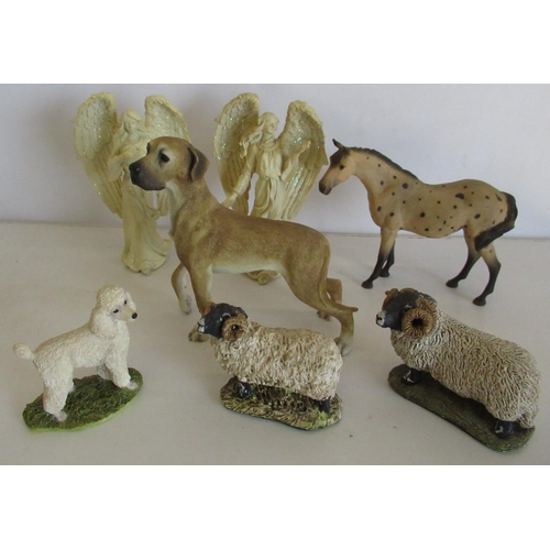 406 - Collection of resin figurines including a Leonardo dog, a horse, a poodle, two sheep and two angels.