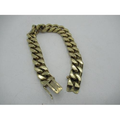 11 - 9ct gold hallmarked flattened curb link bracelet, L19.5cm, 70.8g...