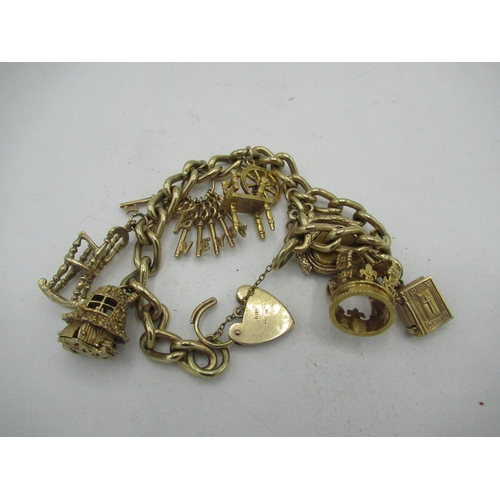 12 - 9ct gold hallmarked charm bracelet hung with seven charms, including enamelled rabbit in toadstool h...