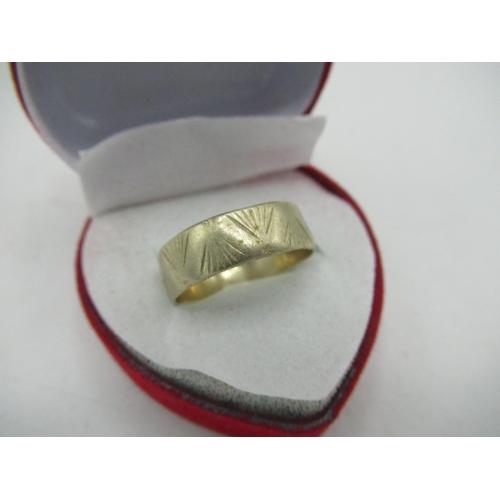 14 - 18ct white gold hallmarked facet cut wedding band, 3.3g...