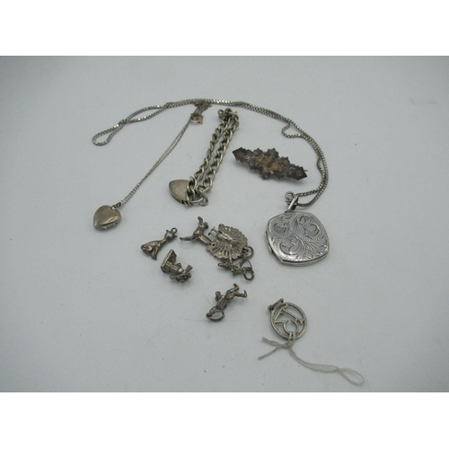 22 - Seven various silver charms, a silver bracelet, two silver lockets and a silver brooch (11), 1.5oz...