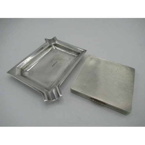 25 - Geo.V silver hallmarked rectangular ashtray, London 1934 by Toye & Co, L12cm and a ER.II silver hall...