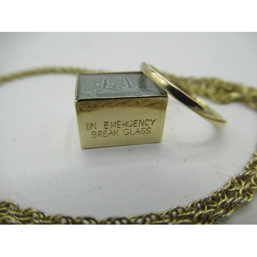 29 - 9ct gold hallmarked plain wedding band 1.1g and a folded £1 note in 9ct case on chain (2)...