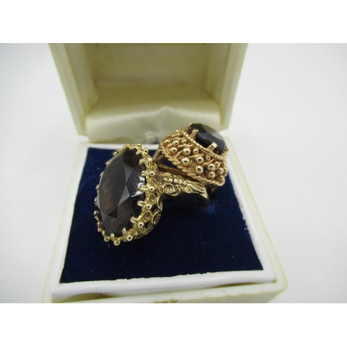 31 - 9ct gold hallmarked dress ring set with a large oval smokey quartz and 9ct gold hallmarked with a ra...