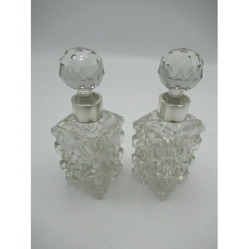 40 - Pair of Edw.V11 facet and strawberry cut glass scent bottles, silver collars hallmarked Birmingham 1...