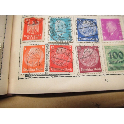 447 - Small stamp album containing a small collection of stamps including Canada France, French colonies, ...