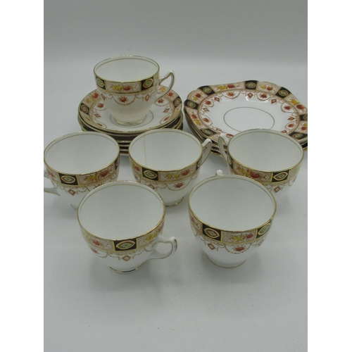 429 - Early 20th C Melba bone china 17 piece dinner service decorated in burnt orange a blue with gilt hig...
