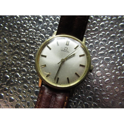 97 - Omega hand wound wrist watch rolled gold case on brown leather strap, snap on stainless steel back s...