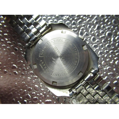 98 - Seiko automatic wrist watch with day date, square shaped stainless steel case on  matching Seiko bra...