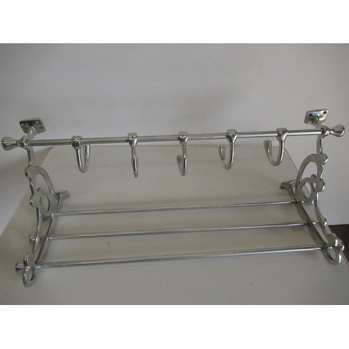 395 - Chrome hat and coat rack, with scroll openwork sides and five hooks, W71cm H30cm